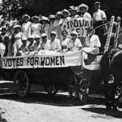 """""""Votes For Women"""" Suffragettes in a Wagon - Courtesy of IHS"""