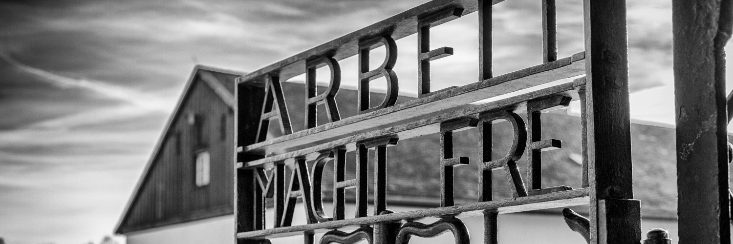 Arbeit Macht Frei on the Gate at Dachau, Photo by Nonethelesser - Own work, CC BY-SA 4.0, from Wikimedia Commons